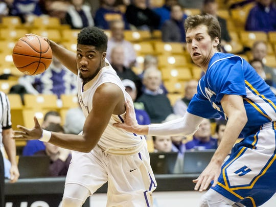 James Madison guard Shakir Brown, left, drives past Hofstra forward Denton Koon during the first half in Harrisonburg, Va., Sunday on Sunday. James Madison won in overtime 98-95.