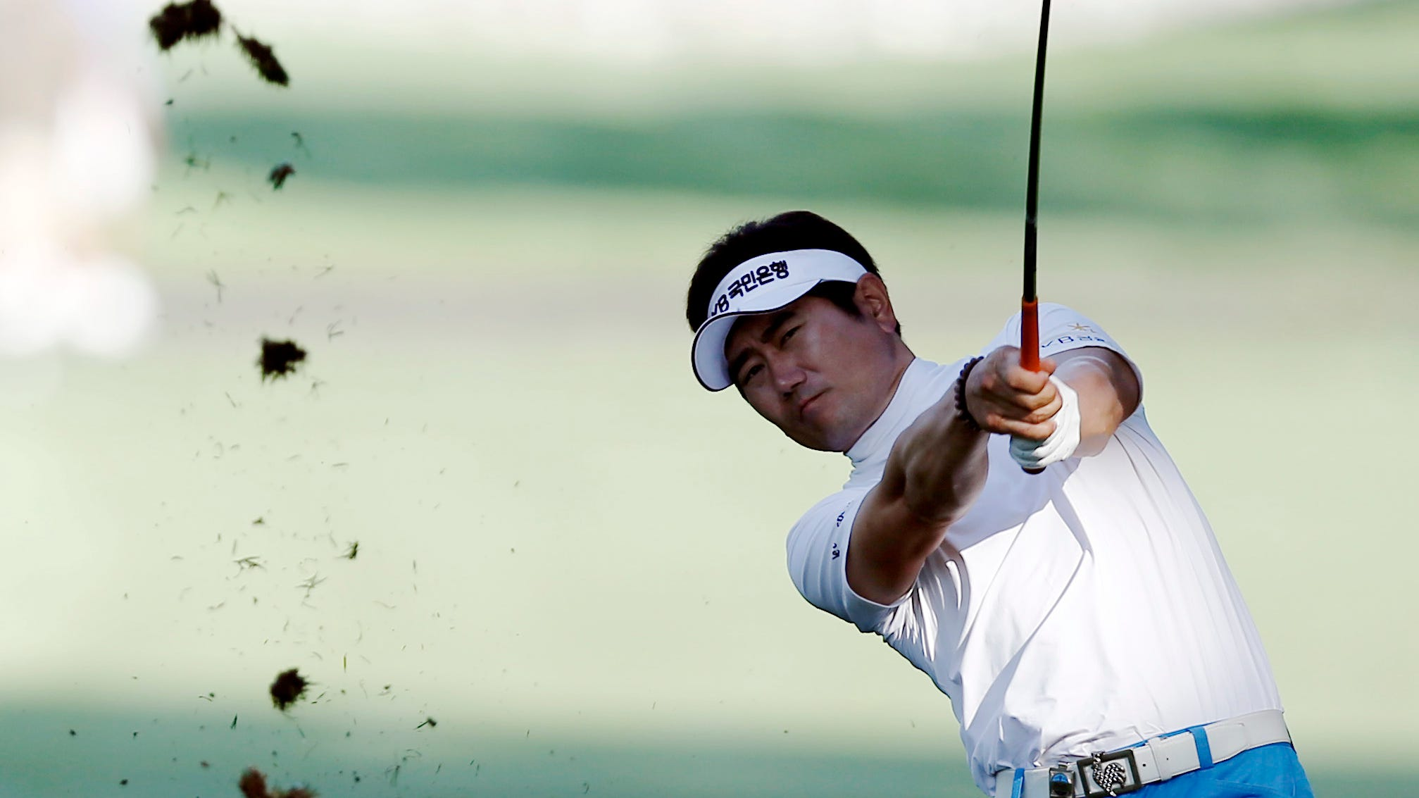 Y.E. Yang plays from the 12th fairway during the first round of the 95th PGA Championship at Oak Hill Country Club.