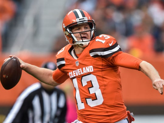 FILE - In this Oct. 30, 2016 file photo, Cleveland Browns quarterback Josh McCown throws in the first half of an NFL football game against the New York Jets in Cleveland. The New York Jets have signed McCown to a one-year deal. The team announced the signing Monday night, March 20. Agent Mike McCartney announced on Twitter that the contract is for one season. Financial terms were not immediately available. (AP Photo/David Richard, File)