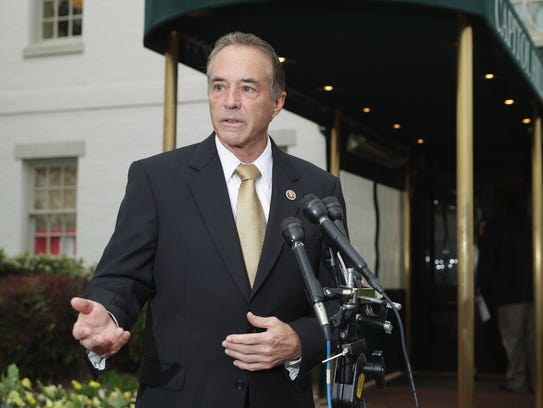 Rep. Chris Collins, R-N.Y., talks to reporters on Capitol