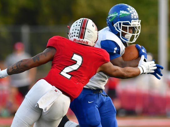 Cornell Beachem rushes for the Winton Woods Warriors