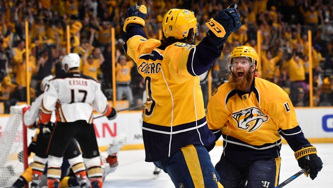 Predators left wing Filip Forsberg (9) celebrates with defenseman Ryan Ellis (4) after scoring Nashville's first goal during the third period of Game 3 of the Western Conference finals Tuesday, May 16, 2017.
