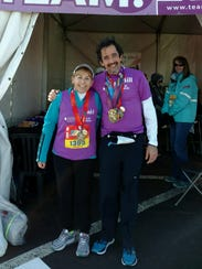 Bernadette Wiggin, left, poses with Team in Training member William Hiemcke at the end of the marathon race at Disney World last year.