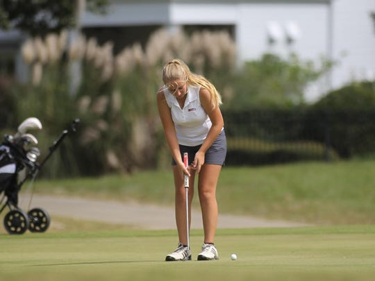 Franklin County's Megan Collins putts during Wednesday's district tournament at Southwood. Collins finished third overall.