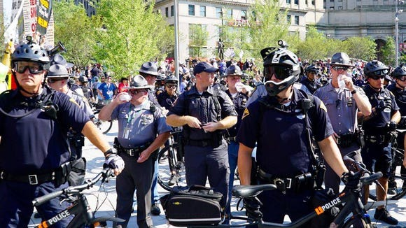 Police used their bodies and bikes to block protest