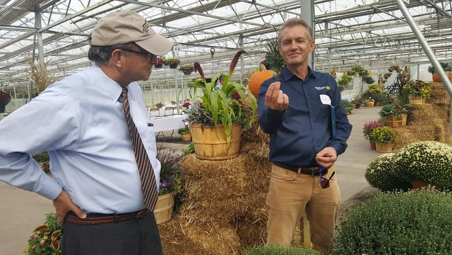 New Jersey Secretary of Agriculture Douglas Fisher touring the Fall trials of ornamental flowers at Kube Pak Open House September 27th in Allentown.