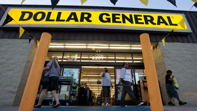 Customers exit a Dollar General store, in San Antonio. There's now a bidding war for Family Dollar, with Dollar General offering about $9.7 billion for the discounter in an effort to trump Dollar Tree's bid of $8.5 billion.