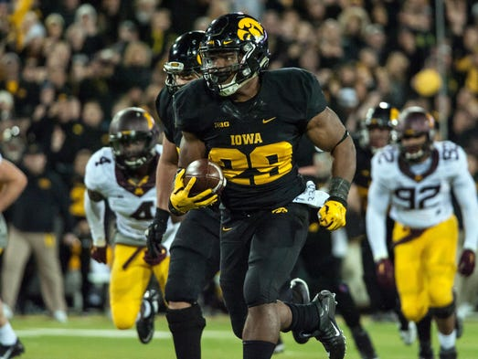 Iowa's LeShun Daniels Jr. runs for a touchdown against