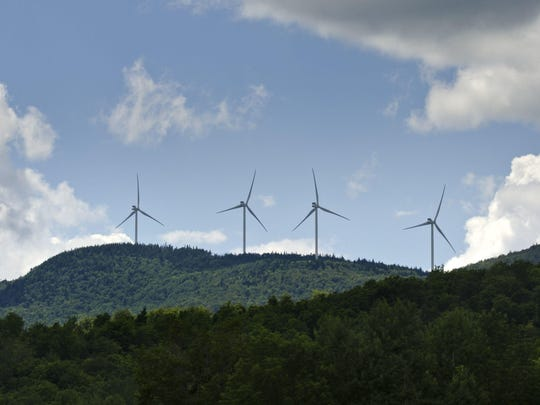 Wind turbines of the Kingdom Community Wind Project on the Lowell Mountain ridge seen from Albany looking to the west on Thursday, July 11, 2013