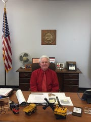 Joe Hart, state mine inspector since 2006, at his desk