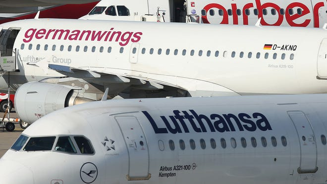 Lufthansa, Germanwings and Air Berlin passenger planes on the tarmac at Tegel Airport on Oct. 21, 2014, in Berlin.