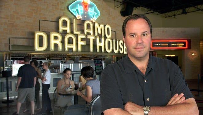 John Martin, a partner in the Alamo Drafthouse Cinemas, is shown in the lobby of an Austin, Texas Alamo Drafthouse in 2004.