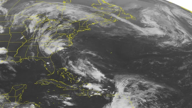 This NOAA satellite image taken at 12:45 a.m. ET Sunday shows Tropical Storm Bonnie moving close to the coast of South Carolina.