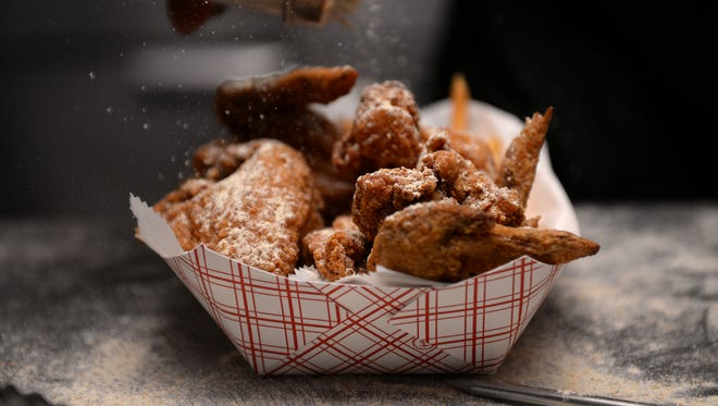 Chicken wings are prepared at Eastside Fish Fry on Wednesday, Sept. 7, 2016 in Lansing.