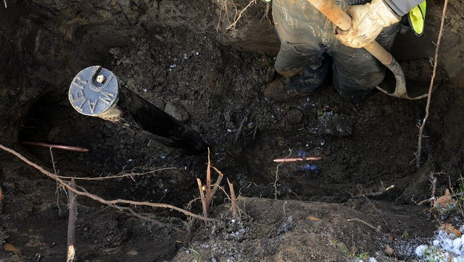 City officials will decide next week whether they will spend thousands of dollars to investigate claims from a city council member — thus far unfounded — that fittings containing lead were used on recent repairs to the city's water system. In this file photo, a new copper water line is installed in Lansing in January of last year.