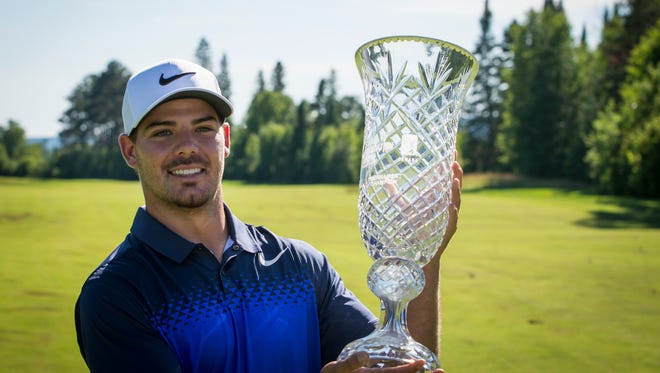 Camarillo High graduate Johnny Ruiz holds the championship trophy after winning the Staal Foundation Open on July 16. A good performance this week will earn Ruiz playing privileges on the Web.com Tour next season.