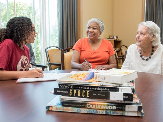 Montessori School of Pensacola seventh-grader Grace Coleman, 13, interviews resident Vonda Banks, 87, right, and her caretaker Laura Jefferson, 70, about their memories of the Space Race during the school's weekly visit to Summer Vista Assisted Living in Pensacola on Tuesday, March 28, 2017.