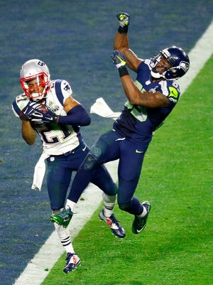 Patriots cornerback Malcolm Butler intercepts a pass intended for Seahawks wide receiver Ricardo Lockette in the closing minute of Super Bowl XLIX at University of Phoenix Stadium in Glendale on Feb. 1, 2015. The Patriots won the game 28-24.