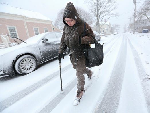 Anne Correia  walks in a snowstorm to visit her mother