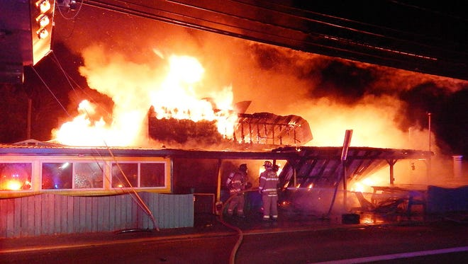 Firefighters respond to Ed's Chicken & Crabs in Dewey Beach early Monday. Owner Ed Riggin said he doesn't expect they will rebuild.
