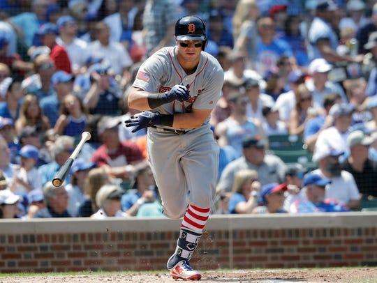 Tigers catcher James McCann drops his bat after hitting