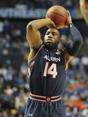 Auburn Tigers guard Antoine Mason (14) shoots from the free throw line during the first half of the fourth round against Kentucky Wildcats of the SEC Conference Tournament at Bridgestone Arena. Mandatory Credit: Jim Brown-USA TODAY Sports