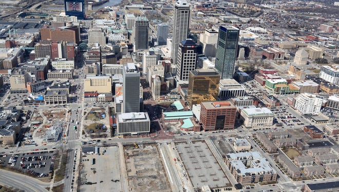 Downtown Indianapolis is seen in this aerial view looking west on March 16, 2015. The empty lots at center foreground is where Market Square Arena once stood.