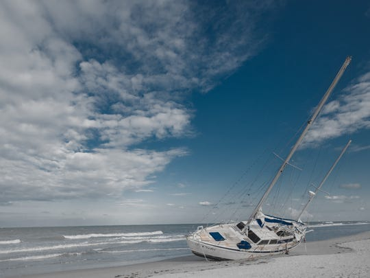 "Vic Pal: ""Just went out by my condo last night and found this sailboat laying on a beach."" Shown is the Cuki mystery sailboat aka a ""ghost ship"" that showed up on Melbourne Beach on Sept. 19, 2017."