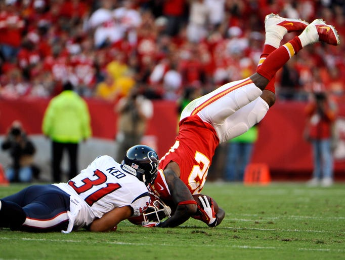 Kansas City Chiefs wide receiver Dwayne Bowe (82) is tackled by Houston Texans free safety Shiloh Keo (31) in the first half at Arrowhead Stadium.