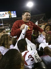Ed Orgeron helped build a dynasty as an assistant at USC, then later served as the Trojans' interim head coach.