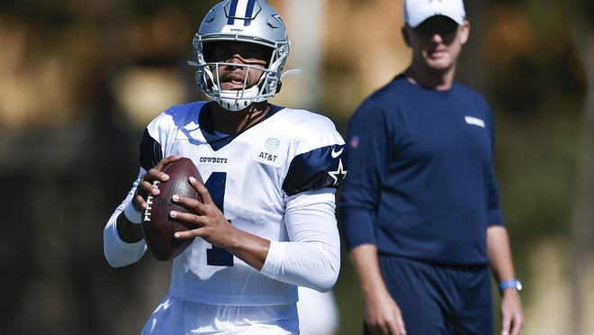 Former Dallas Cowboys head coach Jason Garrett eyes up quarterback Dak Prescott  during last season's training camp. Garrett was fired in the offseason and returns to face his former pupil Sunday as the offensive coordinator of the New York Giants.