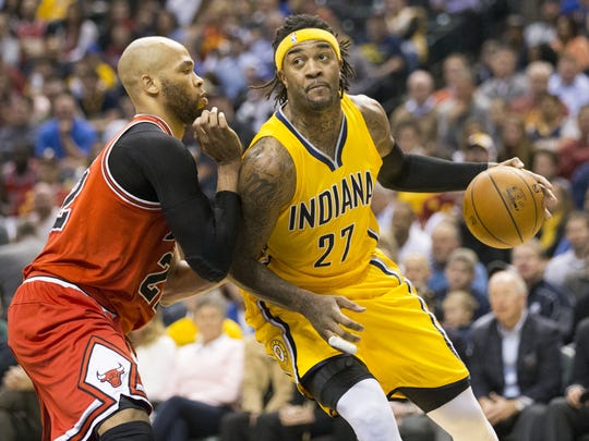 Jordan Hill of Indiana works against Taj Gibson, Chicago