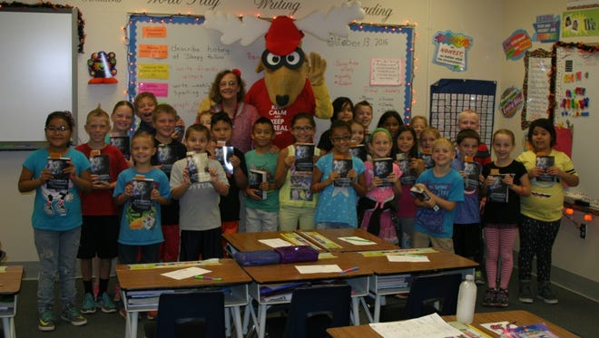Elroy the Elk stands with third-grade teacher Lana Hess and her class of Ute V. Perkins Elementary School students.