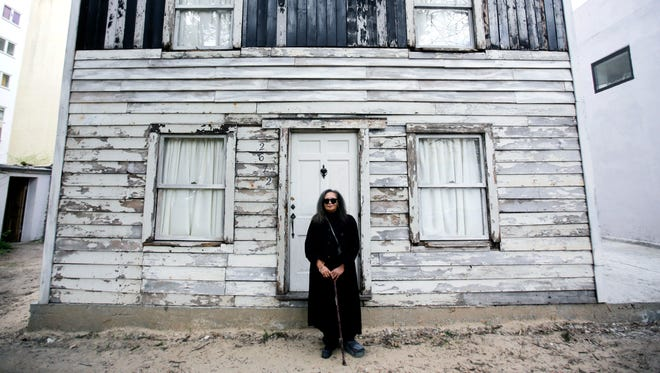 In this April 6, 2017, file photo, Rhea McCauley, a niece of the late civil rights activist Rosa Parks, poses in front of the rebuilt house of Rosa Parks in Berlin. Brown University announced Thursday, March 8, 2018, it has canceled plans to display the house where Rosa Parks lived after sparking the Montgomery bus boycott.