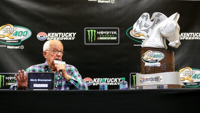 Reds Hall of Fame announcer Marty Brennaman answers questions during a press conference before the NASCAR Monster Energy Cup Series Quaker State 400 race, Saturday, July 14, 2018, at the Kentucky Speedway in Sparta, Ky. (Kareem Elgazzar/The Cincinnati Enquirer)