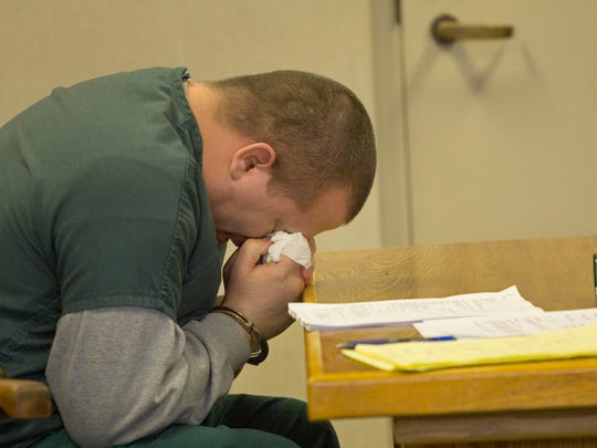 Daniel Whalon, 28, suppresses sobs as he listens to testimony during a pre-sentencing hearing in Vermont Superior Court in Burlington on Monday, for second-degree murder charges in the deadly stabbing of 54-year old Ralph Bell of Burlington.