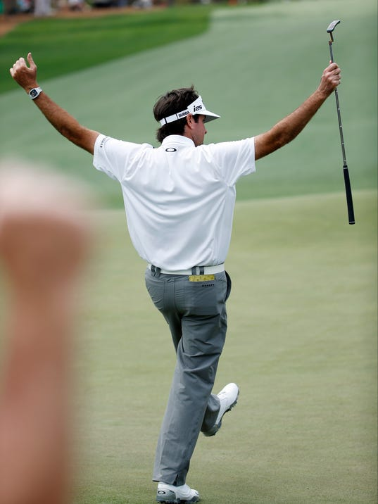 Bubba Watson celebrates after a birdie on the 14th green during the second round of the Masters golf tournament Friday, April 11, 2014, in Augusta, Ga. (AP Photo/Matt Slocum)