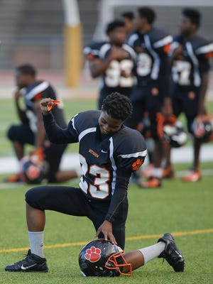 Withrow wide receiver Jaylen Willis takes a knee during the national anthem before Friday's game against Glen Este.