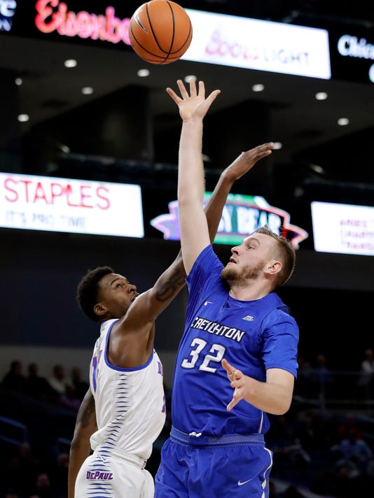 Creighton forward Toby Hegner, right, shoots over DePaul forward Paul Reed during the first half of an NCAA college basketball game Wednesday, Feb. 7, 2018, in Chicago. (AP Photo/Nam Y. Huh)
