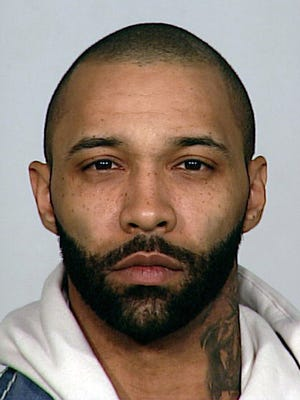 In this undated photo provided by the New York City Police Department, rapper and reality show star Joe Budden is shown. Budden is wanted by the NYPD for allegedly stealing his ex-girlfriend?s cell phone and twisting her arm during a dispute in the early-morning hours of Monday, Aug. 18, 2014. (AP Photo/New York City Police Department)