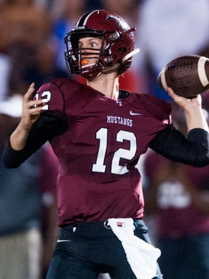 Stanhope Elmore quarterback Phillip Warlick (12) throws against Wetumpka at the SEHS campus in Millbrook, Ala., on Friday September 9, 2016.