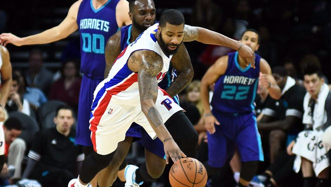 Pistons forward Marcus Morris brings the ball up court against the Charlotte Hornets during the first quarter Wednesday at the Palace.