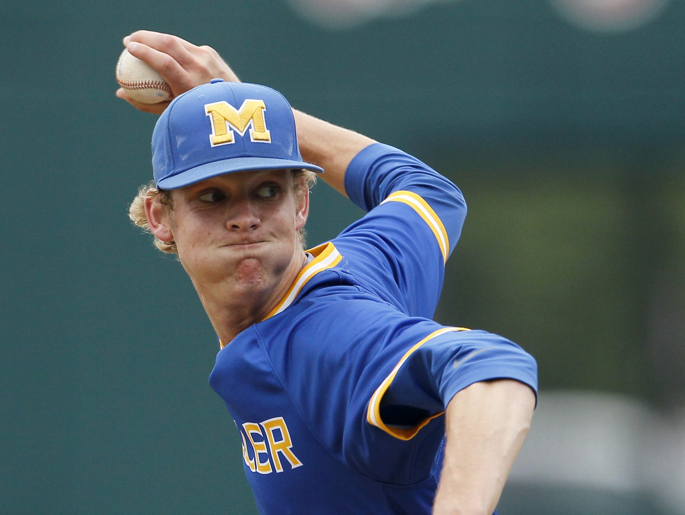 Moeller senior Grant Macciocchi (1) delivers a pitch in the bottom of the fourth inning.
