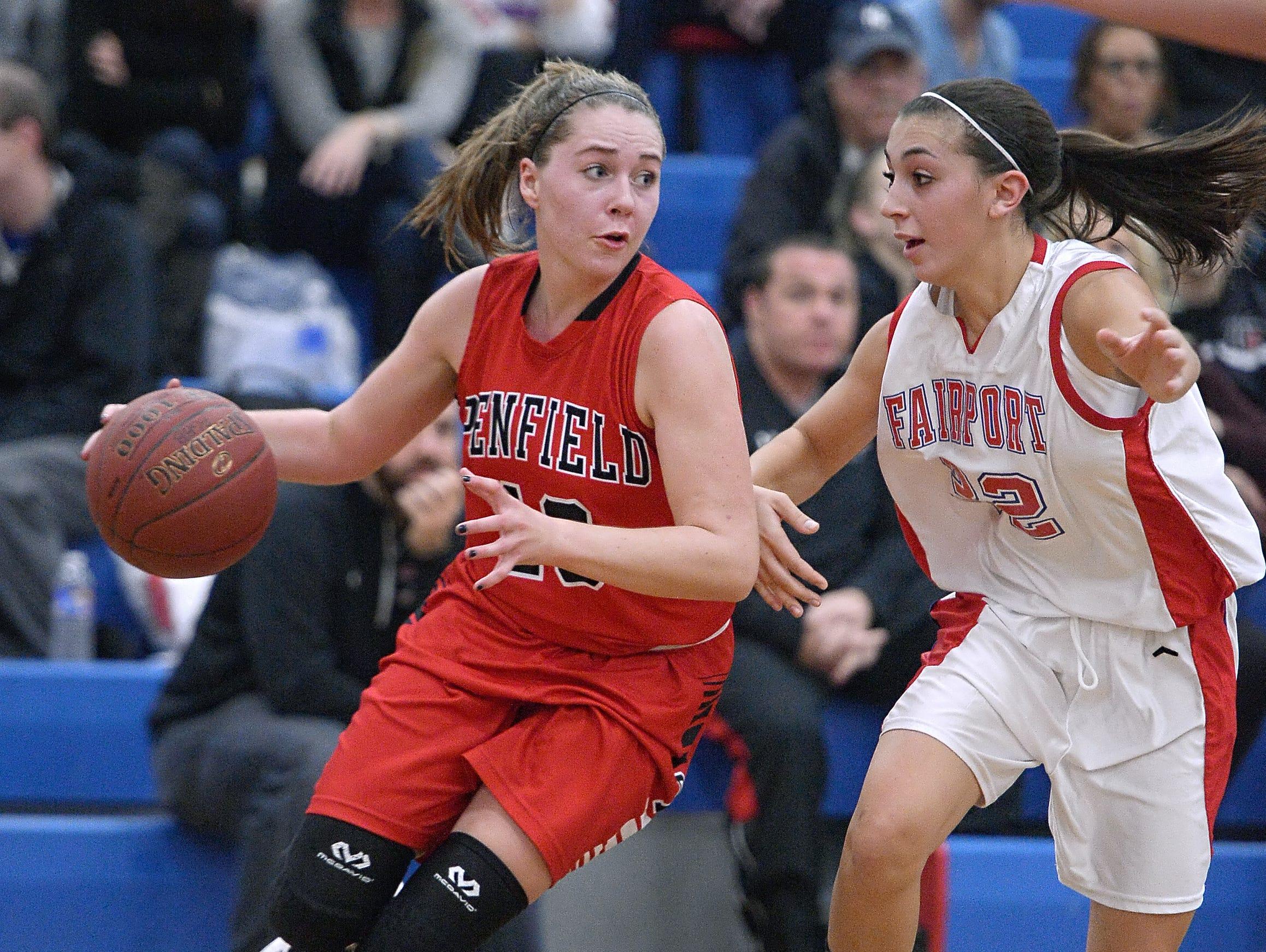 Penfield's Kristen Baumer, left, drives the baseline against Fairport's Megan Yawman.