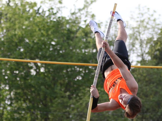 Silverton's Isaac Rush competes in the pole vault on Friday, April 15, 2016, during the Vikings Relays Twilight Invitational track and field meet at North Salem High School.