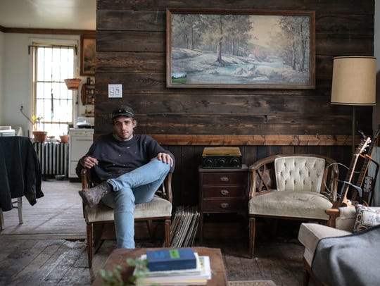 Detroit artist Pat Perry poses for a photo at his home