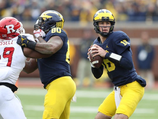 Michigan's Brandon Peters looks to pass against Rutgers