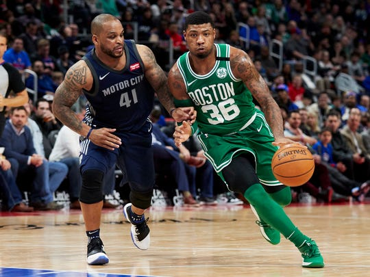 Boston Celtics guard Marcus Smart (36) dribbles defended
