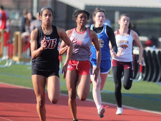 Ryle junior Juliet McGregor, left, wins the 100 ahead