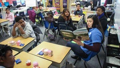 Asbury Park Press staffers read to students at Thurgood Marshall Elementary School.